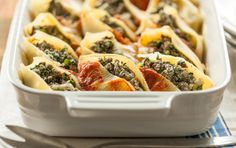 Baked spinach and feta stuffed shells.....A mixture of ricotta, spinach and ground beef makes this classic baked pasta dish particularly satisfying. Grass-fed beef is rich and flavorful, so cooking with even a small amount makes a big impact.