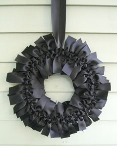 This ribbon wreath is so super simple to make, and you can hang like this or decorate with ornaments and other things. This would be a great way to make other holiday wreaths as well such as Valentines, Easter, July 4th, etc. Would also be great to hang on door for your bday child in the color scheme and theme of their party.