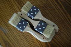 Paint brush and ribbon for guests to dust sand off of their feet after the ceremony.