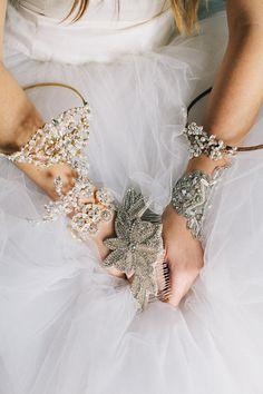 bridal jewels galore, photo by Natasha Hurley http://ruffledblog.com/winter-whites-wedding-inspiration #wedding #jewelry #accessories