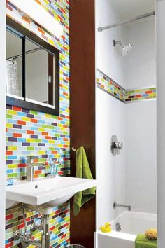 Guarantee that nary a visitor will forget your home's small bath by imprinting a rainbow of glass mosaic tile on their brains. If an accent wall is too extreme, go for just a colorful band in the shower for a fun surprise. | Photo: Jürgen Frank