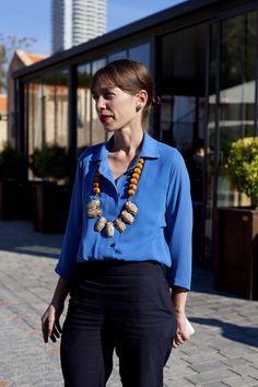 Big fabulous necklace & a lovely blue button down. Photo by Yael Sloma