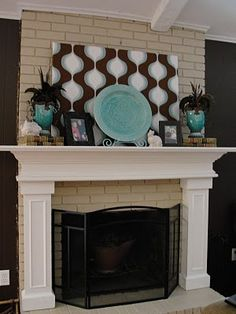 Not only is this a fun inspiration for color and/or style, the blog actually has some great thoughts on balancing the accessories on a mantel. :)