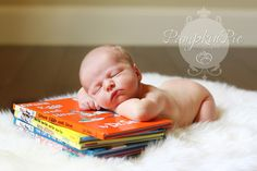 Baby on a stack of Dr. Seuss books