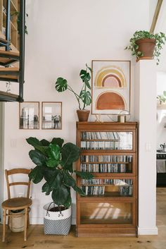 my scandinavian home: Before And After: A Drab Cape Town Interior Becomes A Warm And Cosy Cottage - wooden glass cabinet, art and plants / bohemian style