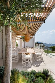 "Infused in elegance with focused attention to comfort and style, The Amelia Dining Chair by Azzurro Living makes a statement in any entertainment space. The breezy character is accentuated through a distinctive hand-knotted rope pattern that couples soft curves and precise angles. Crisp lines of the Sunbrella® fabric cushion refine the design making it suitable for outdoors or in. This dining chair sits beautifully with the Big Sur Round 48"" Dining Table by Azzurro Living."