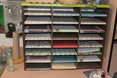 Teachers who tried and abandoned scrapbooking are finding many uses for leftover scrapbook paper. In Andrea Smith's 4th grade classroom, the paper dresses up storage shelves.