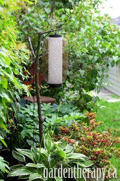DIY Branch Outdoor Lamp Project via Garden Therapy #garden #lighting