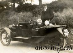 This car has two wheels in the front, one in the back. Do you recognize this model? Photo was taken in England in 1935.   Learn more: http://www.ancientfaces.com/research/photo/1246235/william-o-j-bright-and-daughters-family-photo