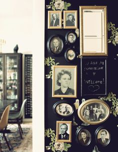 Amazing, vintage family portrait wall. Love the way the gold and black compliment each other and the mirror is the piece de resistance