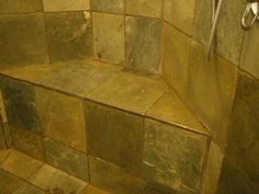 Cleaning slate tile showers.