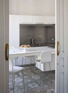 white kitchen with cement tile