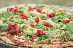 Cauliflower Pizza crust loaded up with healthy veggies. Gluten-free and low-carb.