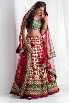 Pure rawsilk ghagra and blouse with net dupatta embellished with thread, pearl and zardozi work