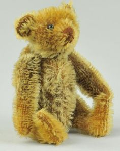 STEIFF RATTLE TEDDY BEAR WITH BIG BUTTON c. 1910, a beloved rattle bear in exceptional condition since rattle works well, underlined ff Steiff.