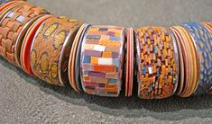 work by Cynthia Toops. using sewing bobbins as a bead base.