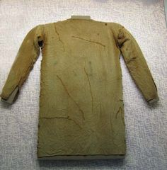 Thorsberg - germanic tunic found in moor made in ca 4th century. Now located in Gottorp Palace, Schleswig, Germany    Copyright Martina a Martin Høibovi © 2006
