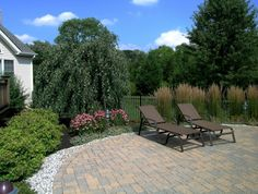 landscaping around pool | Custom landscaping around a paving brick pool deck is a big part in ...