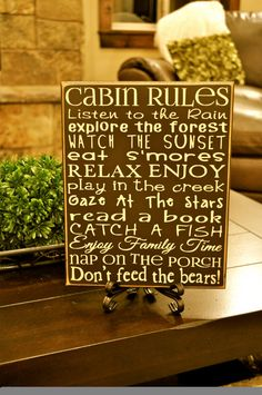 wood sign, white cabin, cabin rules