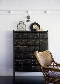 Love this painted black cabinet with faint gold writing. Would love to do a treatment like this.