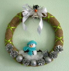 How adorable is this Decorative Snowman Burlap Wreath! It's the perfect touch to your winter decorations!