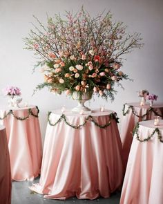 Blossoming branches paired with French tulips make quite a statement