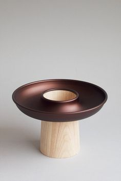 carlo clopath / ciambella / material: aluminium and wood  / process: metal spinning and wood turning / client: écal + Alessi / 2011