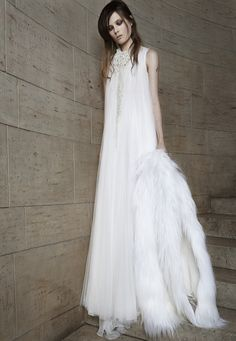 Look 5. Ivory sleeveless crew neck soft tulle gown with gathered detail and empire godets.