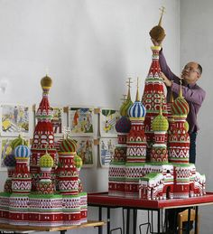 Sergei Tarasov, 42, puts the finishing touches to his incredible modular origami model of Saint Basil's Cathedral at his home in Tigritskoye