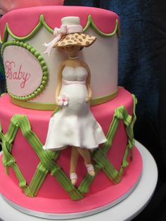 Modern baby shower cake with sugar figurine by intricate icings cake design