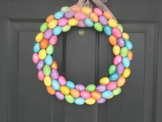 DIY Easter Egg Wreath Craft: Perfect for your door or as a centerpiece. Get everything you need at Dollar Tree!