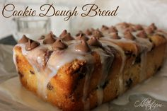 ~Cookie Dough Bread!   Oh Bite It 2-5 oz. containers of Vanilla Greek Yogurt  1 1/2 cups Self Rising Four  1/2 cup Sour Cream  1/2 cup Sugar  1-11 oz. bag of Chocolate Chips (reserving 1/3 cup for the topping)  1 tbs. Vanilla Extract  The Glaze:  1 cup Powdered Sugar  1 tbs. Vanilla Extract  a few splashes of Milk