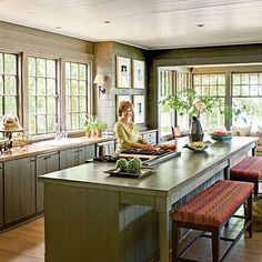 Topped with poured concrete, the extra-large island has ample bench seating. | SouthernLiving.com
