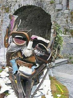 Slow down when you walk past this garbage pile portrait {surreal mixed-media stacked rubbish street artwork}