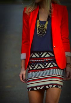 bold and effortless, geometric pencil skirt, bright red orange blazer with rolled up cuffs, blue tank and gold chain necklace