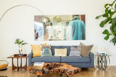 Create A One-Of-A-Kind Space With These Creative Decor Tips #refinery29  http://www.refinery29.com/decorist-house-tour#slide11  Don't be afraid to go the unmatchy route. Use various side tables,  textures, and materials, and a medley of pillow patterns.