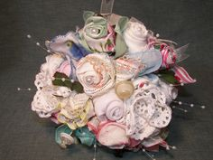 """Handmade bridal bouquet designed with """"hankie roses"""" created from vintage handkerchiefs, shabby chic buttons, lace and doilies. $150.00, via Etsy."""