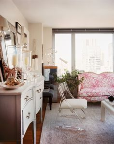 Living Room Photo - A Lucite chair beside a white sideboard