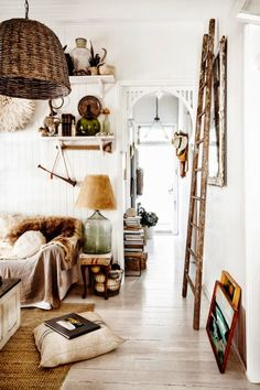 Artfully placed clutter. This is a style I can roll with :-D #decorating #home #livingroom ladder, beach houses