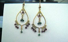 Can't justify buying solid 24k Gold earrings in this economy?  Then the pictured earrings are for you!  These beautiful ear ornaments are made with 24k Gold Vermeil.  Vermeil is 24k Gold bonded over Sterling Silver & the adherence lasts a long time.  The Semi precious stones you see are Rubies & Emeralds.  Opening bid is 32.00 or you can buy them now for 36.00.  The price can't be beat for the value. Be the envy of all & no one has to know they are Vermeil.  Don't let these get away, buy today