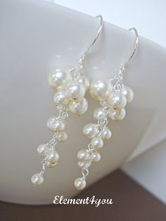 Pearl Wedding Earrings. Bridal Earrings. Statement Earrings. Ivory Pearl Earrings. Long Cluster Earrings. Wedding Jewellery. White pearls.. $30.00, via Etsy.