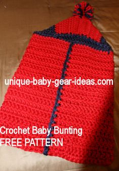 Make a hooded Crochet Baby Bunting from a FREE Hooded Baby Bath Towel Patterns using super chunky, bulky yarn with a few changes in the instructions.  What a great baby shower gift this is for a baby boy shower in a football theme.  Red and blue are the team colors for the darling of SEC football, Ole Miss!  University of Mississippi sports fans will love this!