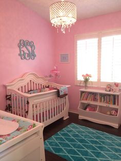 This custom wood monogram from @spottedzebras adds such a personal, girly touch to this pink nursery!