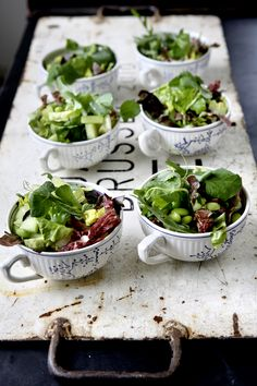 Individual salads served in tea cups.