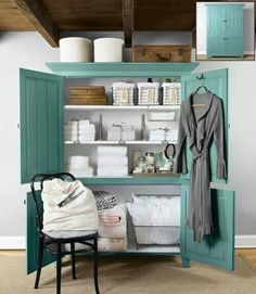 Armoire is turned into great storage for guest room. #Organization #repurposed #upcycle