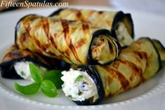 Cut eggplant into thin slices, grill, and roll with an herbed ricotta mixture.