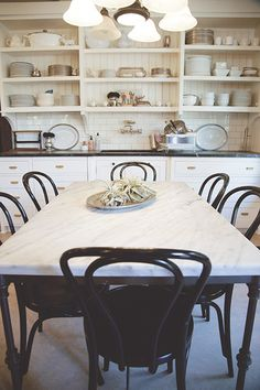 White cabinets, marble and pipe table, thonet chairs Living With Kids: Mary Heffernan