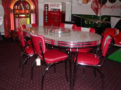 retro kitchen tables and chairs This reminds me of the one we had  growing up except the chairs were gray.....