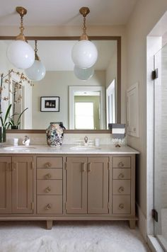 wall to wall mirror, vintage fixtures,  painted vanity.