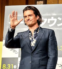 Orlando Bloom wore a lovely floral shirt and and blue blazer during a press conference for his new film Zulu in Tokyo.